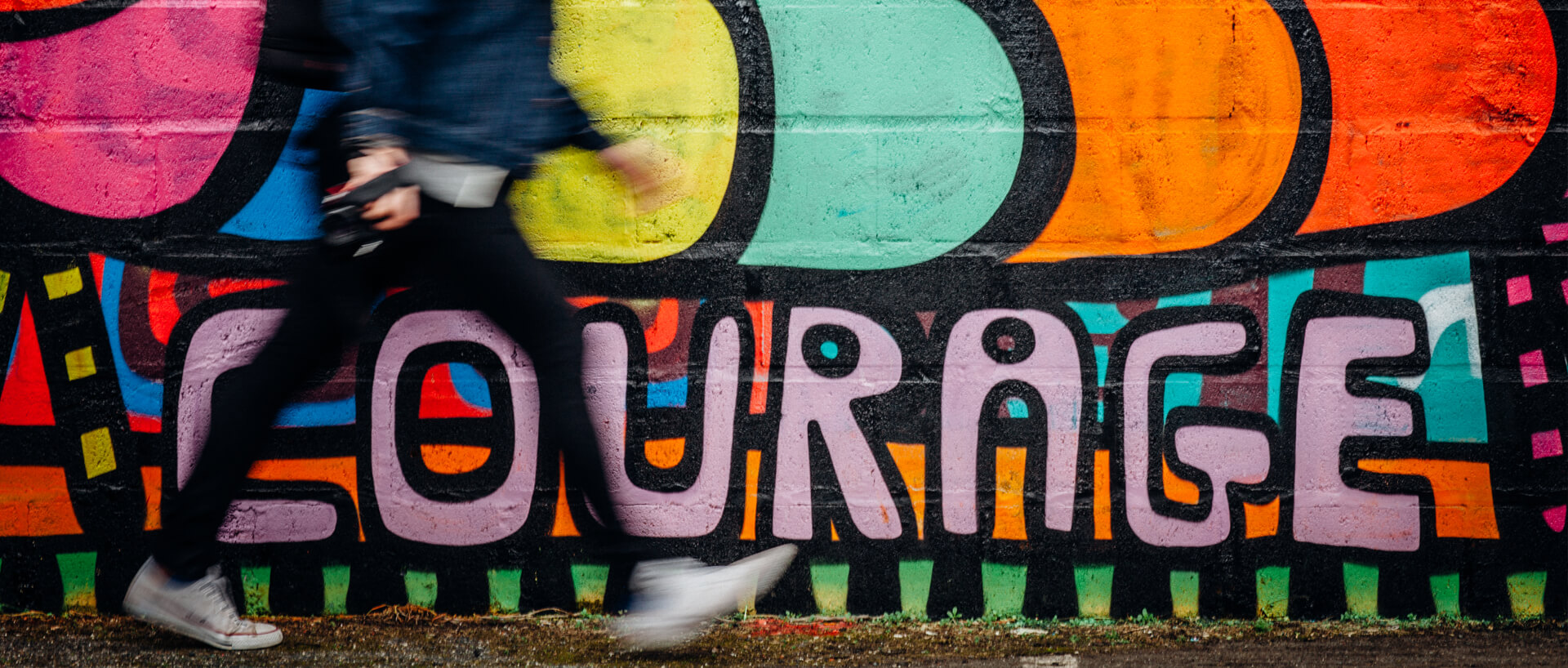 "colourful graffiti that says ""courage"""