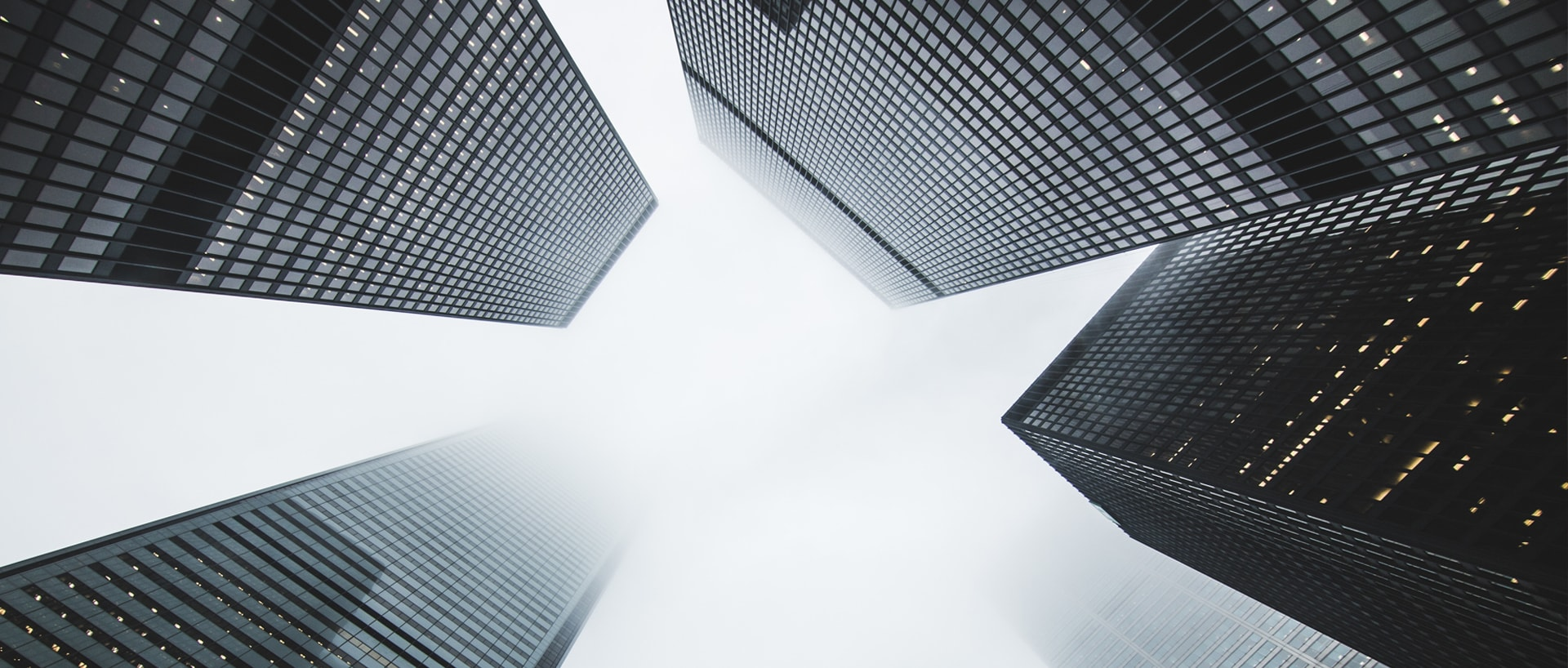 Tall office buildings in the fog